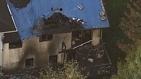 Surrey firefighters respond to a fire at a home were a 51-year-old man was murdered a week earlier. Oct. 13, 2010. (CTV)