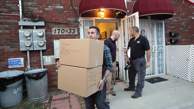 Law enforcement officials remove boxes of potential evidence from the New York home where Quazi Mohammad Rezwanul Ahsan Nafis was staying, Wednesday, Oct. 17, 2012. (Newsday / Howard Schnapp)