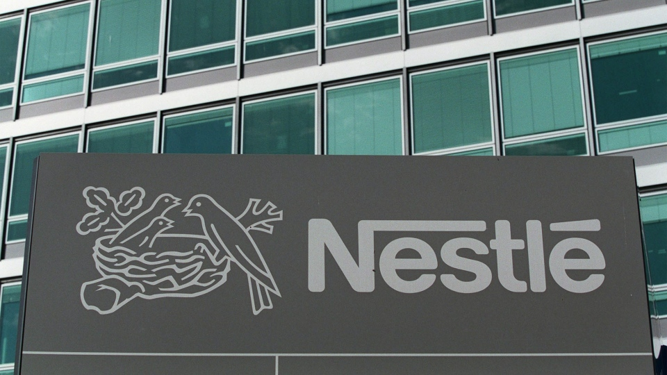 In this Sept. 24, 1999 file picture the logo of Swiss food an drink company Nestle is pictured in Vevey, Switzerland. (AP / Keystone / Fabrice Coffrini)