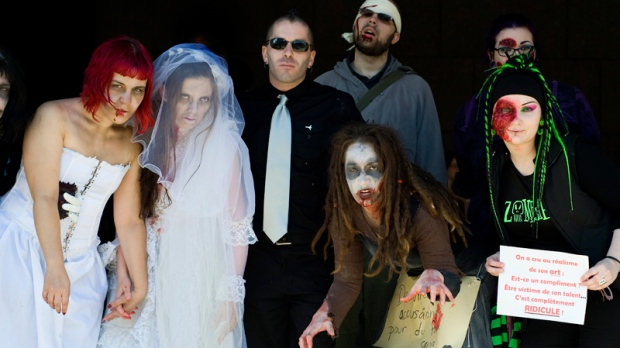 Special effects filmmaker Remy Couture, centre, demonstrates outside the Montreal courthouse with supporters dressed as zombies, in Montreal, Wednesday, October 13, 2010. (Graham Hughes / THE CANADIAN PRESS)