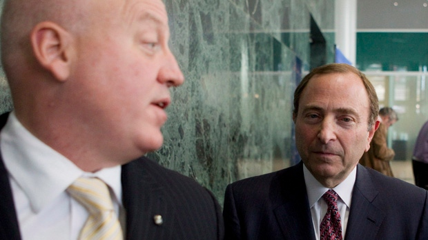 NHL commissioner Gary Bettman, right, leaves with deputy commissioner Bill Daly after collective bargaining talks in Toronto on Tuesday, Oct. 16, 2012. (Chris Young / THE CANADIAN PRESS)