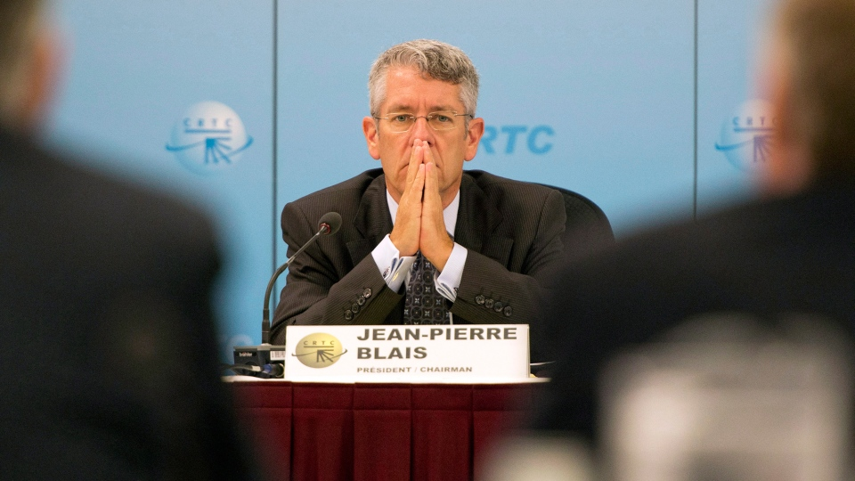 CRTC Chairman Jean-Pierre Blais listens to presenters at the Canadian Radio and Television Commission hearings on the Bell-Astral merger Wednesday, Sept. 12, 2012 in Montreal. (Ryan Remiorz / THE CANADIAN PRESS)