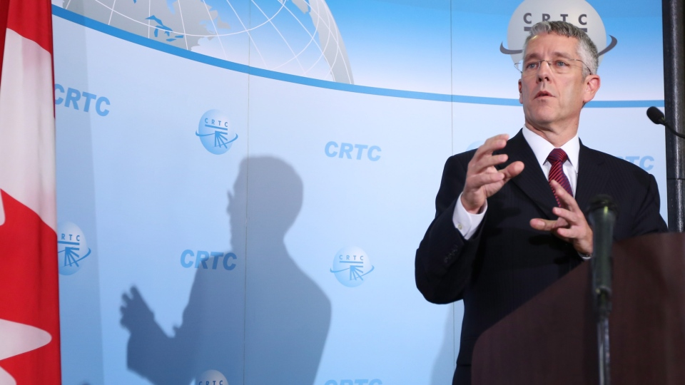 CRTC Chairman Jean- Pierre Blais holds a news conference in Gatineau Quebec to anounce that the CRTC has rejected Bell Media's bid to purchase Astral Media , Thursday Oct. 18, 2012. (Fred Chartrand / THE CANADIAN PRESS)