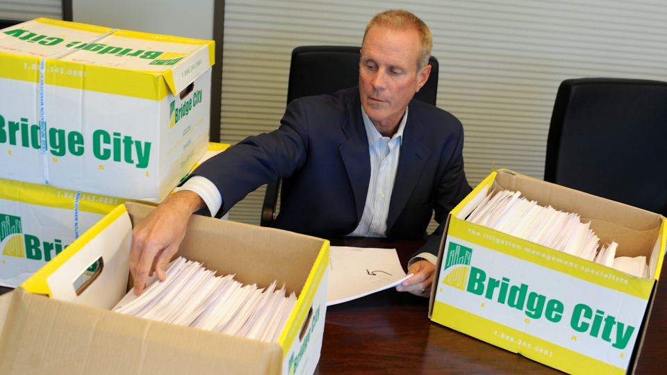 Attorney Kelly Clark examines some of the 14,500 pages of previously confidential documents created by the Boy Scouts of America concerning child sexual abuse within the organization in his office in Portland, Ore., Tuesday, Oct., 16, 2012. (AP / Greg Wahl-Stephens)