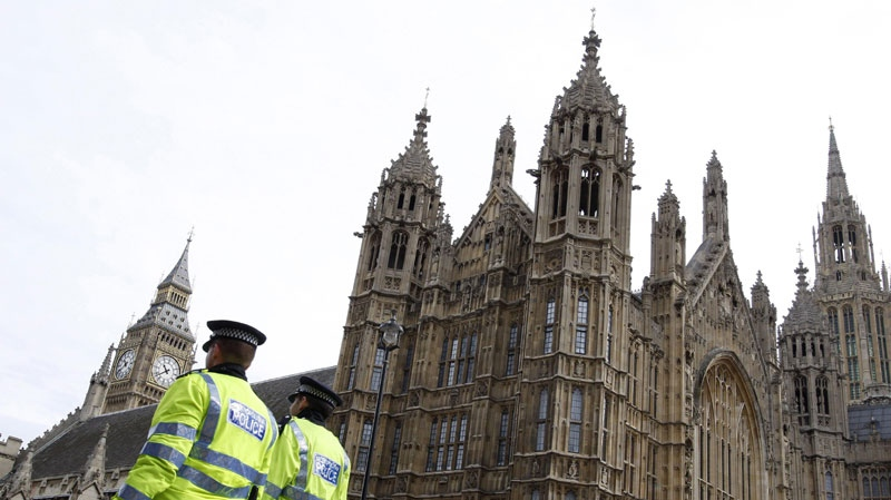 Police officers patrol past The Houses of Parliament in London, Friday, April 10, 2009. (AP Photo/Kirsty Wigglesworth)