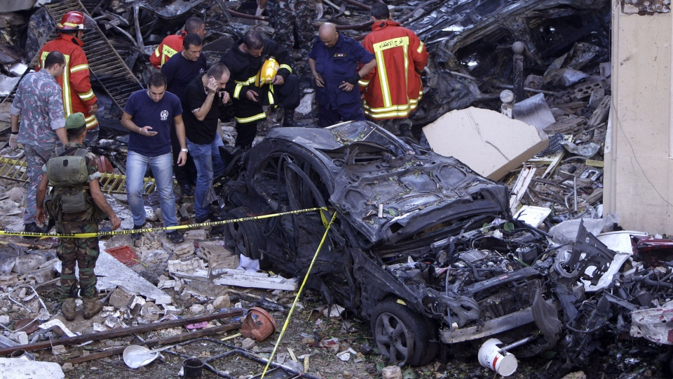 Lebanese soldiers and rescue workers inspect damage from an explosion in the mostly Christian neighborhood of Achrafiyeh, Beirut, Lebanon, Friday Oct. 19, 2012. (AP / Bilal Hussein)