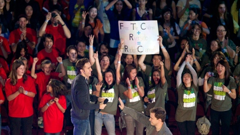 "Craig and Marc Kielburger are greeted by fans as they arrive for the 2010 Free The Children ""We Day"" at the Rogers Arena in Vancouver, Friday, Oct. 15, 2010. THE CANADIAN PRESS/Jonathan Hayward"