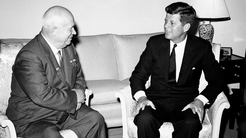 Soviet Premier Nikita Khrushchev and U.S. President John F. Kennedy talk in the residence of the U.S. Ambassador in a suburb of Vienna, June 3, 1961. (AP Photo)