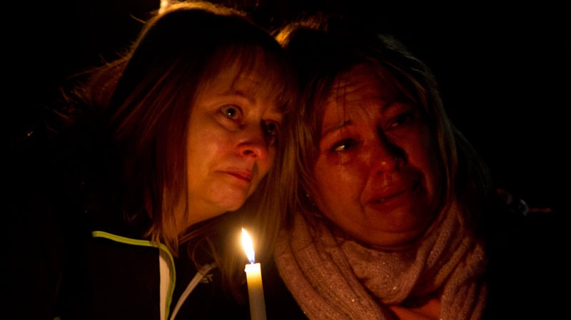People gather during a memorial for Amanda Todd in Surrey, B.C., on Friday, Oct. 19, 2012. (Jonathan Hayward / The Canadian Press)