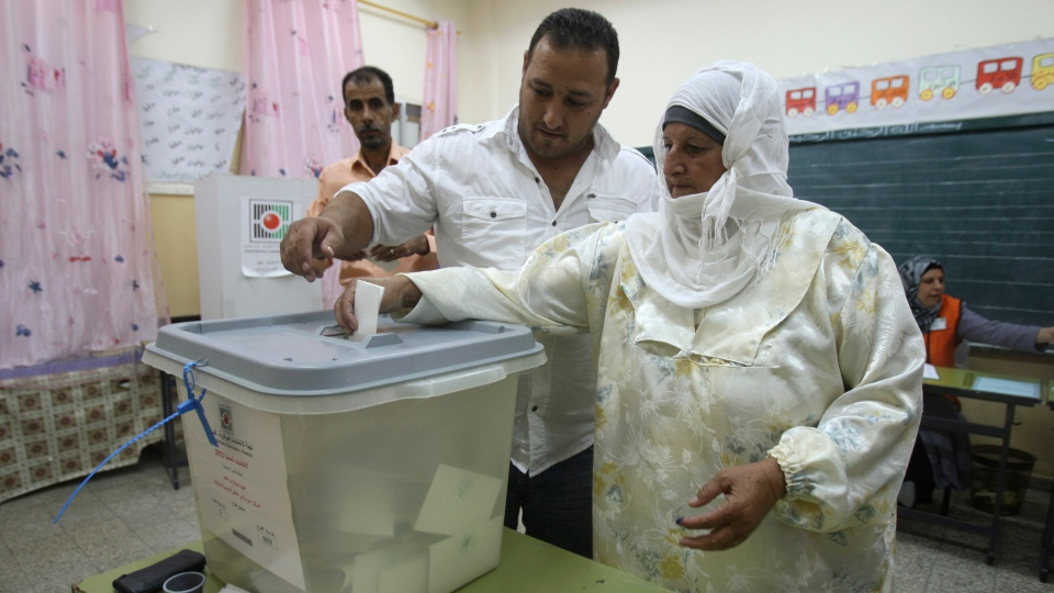 A Palestinian woman casts her vote in municipal elections at a polling station in the West Bank city of Nablus, Saturday, Oct. 20, 2012. (AP / Nasser Ishtayeh)