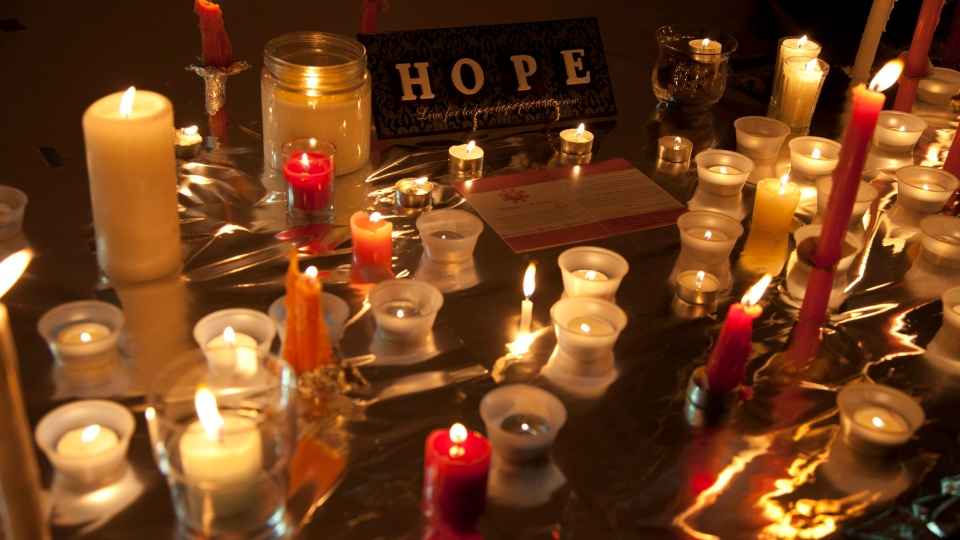 Candles are seen during a memorial for Amanda Todd in Surrey, B.C., on Friday, Oct. 19, 2012. (Jonathan Hayward / THE CANADIAN PRESS)