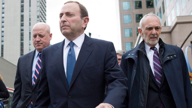 NHL Commissioner Gary Bettman, left, leaves the NHLPA offices with Assistant Commissioner Bill Daly (left) and NHL lawyer Bob Betterman following collective bargaining in Toronto on Thursday, Oct. 18, 2012. (Chris Young/ THE CANADIAN PRESS)