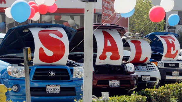 'Sale' is spelled out in the open hoods of used cars at a Toyota dealership on Sept. 18, 2010. (AP / Reed Saxon)