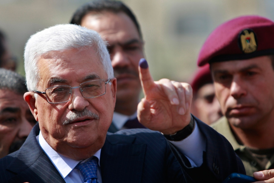 Palestinian President Mahmoud Abbas shows his ink-stained finger after casting his vote during local elections at a polling station in the West Bank city of Ramallah, Saturday, Oct. 20, 2012. (AP / Majdi Mohammed)
