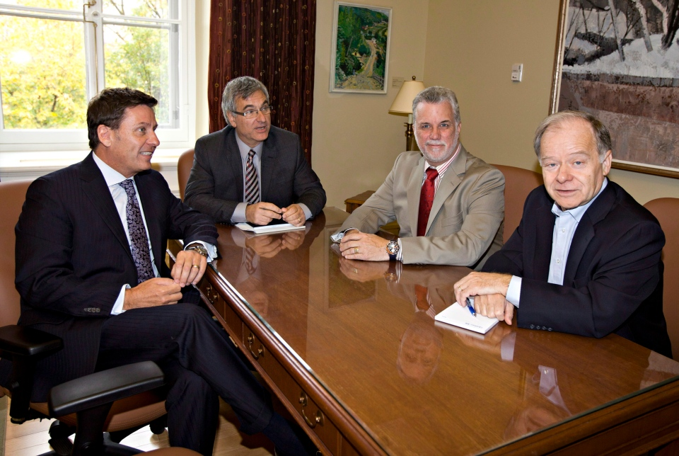 FILE: Candidates for the Quebec Liberal Leadership meet Opposition interim leader Jean-Marc Fournier Wednesday, October 10, 2012 at the legislature in Quebec City. From the left, Pierre Moreau, Jean-Marc Fournier, Philippe Couillard and Raymond Bachand. THE CANADIAN PRESS/Jacques Boissinot