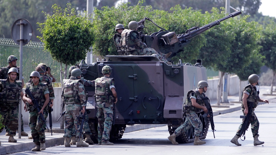 Lebanese Army soldiers deploy after overnight clashes between Sunni and Shiite gunmen in Beirut, Lebanon, Monday, Oct. 22, 2012. (AP / Hussein Malla)
