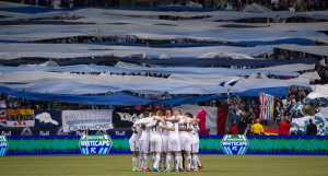 Vancouver Whitecaps players huddle together before playing the Portland Timbers during an MLS soccer game in Vancouver on Sunday, Oct. 21, 2012. (Darryl Dyck / THE CANADIAN PRESS)