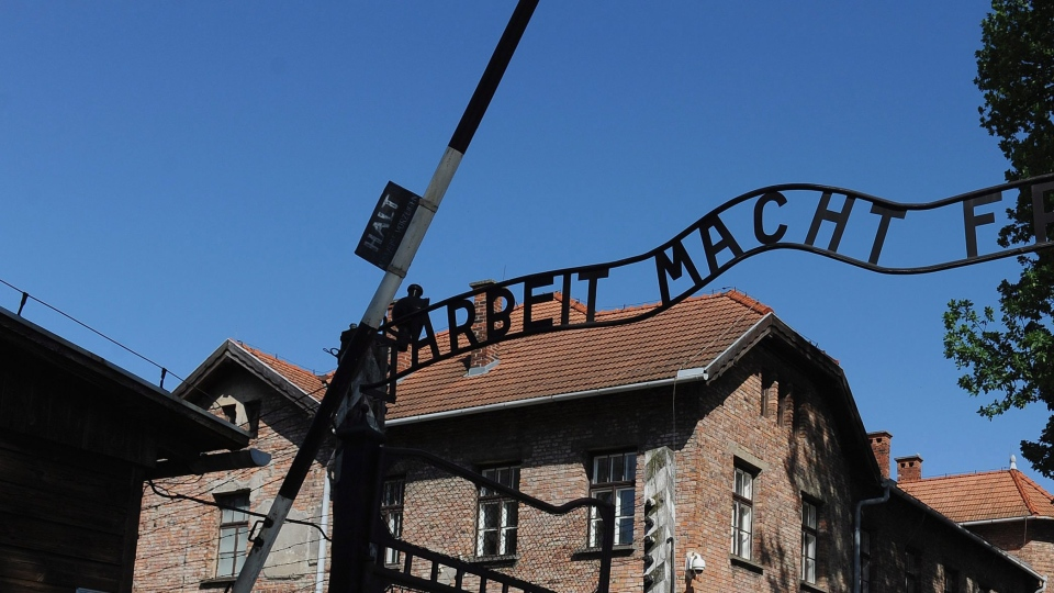 A sign is shown above the entrance to the Auschwitz death camp. (Michael Regan / The FA)