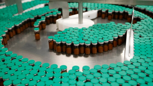 Swine flu vaccines are seen at the Sanofi-Pasteur production plant in Val-de-Reuil, western Paris, in this photo taken Oct. 19, 2009. (AP / Jacques Brinon)