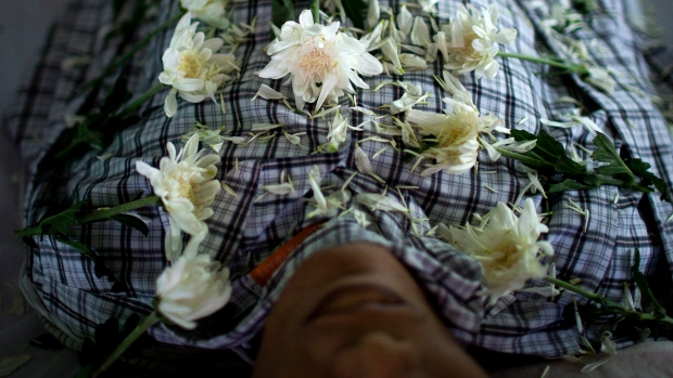 Chrysanthemum flowers arranged on HIV victim