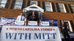 Former Pennsylvania Sen. and former presidential candidate, Rick Santorum, center, speaks to supporters during an 'Early Voting Victory' event for Republican presidential candidate, former Massachusetts Gov. Mitt Romney in Charlotte, N.C., Thursday, Oct. 18, 2012. (AP Photo/Chuck Burton)