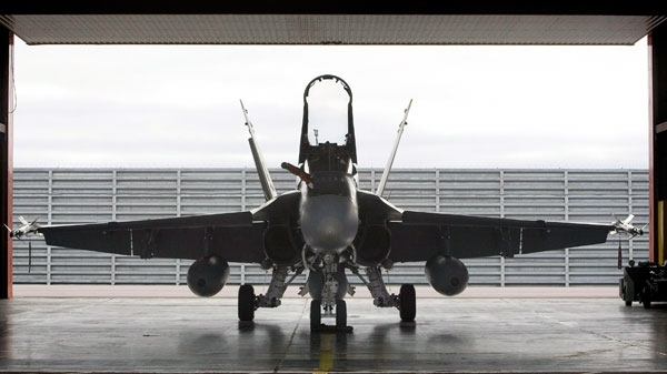 A Canadian Forces CF-18 sits in its hangar at the air base in Inuvik, Northwest Territories on Thursday Aug. 28, 2008. (Tom Hanson / THE CANADIAN PRESS)