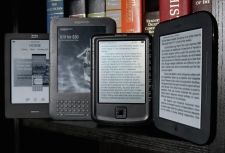 The Kobo eReader Touch, an Amazon Kindle, an Aluratek Libre Air, and a Barnes & Noble Nook, left to right, are displayed in this photo, in New York, Tuesday, June 14, 2011. (AP Photo/Richard Drew)
