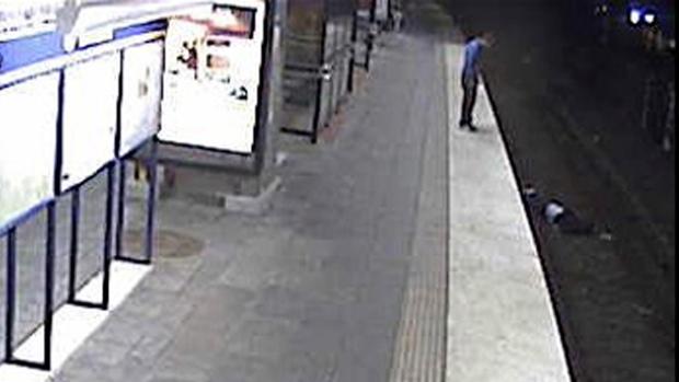 Khiari stands over his victim at Sandsborg station