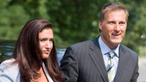 Maxime Bernier arrives to be sworn in as the new Minister of Foreign Affairs accompanied by Julie Couillard during a ceremony at Rideau Hall in Ottawa on Aug. 14, 2007. (Paul Chiasson / THE CANADIAN PRESS)