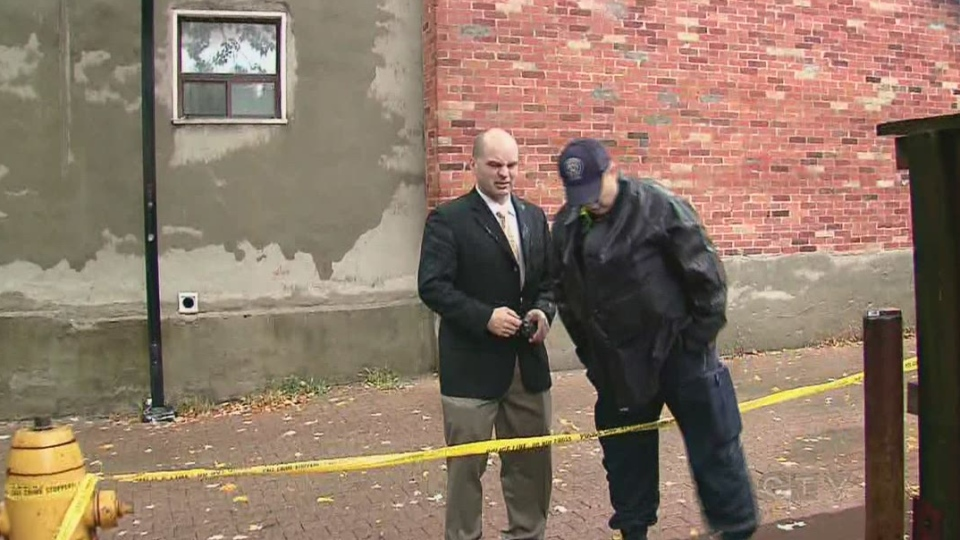 Police investigate the murder of a woman on Ontario Street in Toronto on Tuesday Oct. 23, 2012.