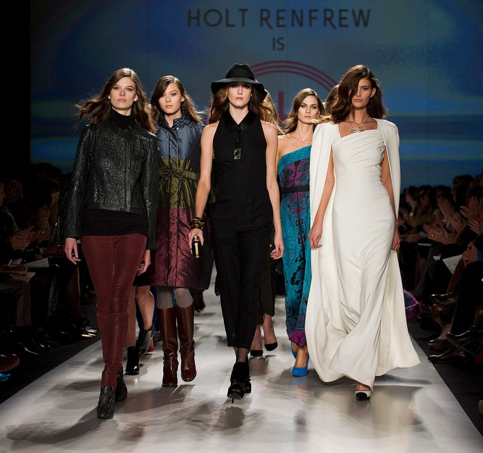 Models walk the runway for the Holt Renfrew collection during opening night of Toronto Fashion Week on Monday, Oct. 22, 2012. (Aaron Vincent Elkaim / THE CANADIAN PRESS)