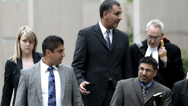 Dave Basi, centre, and his lawyer Michael Bolton, far right, Bobby Virk, lower right, and Aneal Basi, 2nd left, and his lawyer Erin Dance, left, leave B.C. Supreme Court in Vancouver, B.C., on Monday October 18, 2010. (Darryl Dyck / THE CANADIAN PRESS)