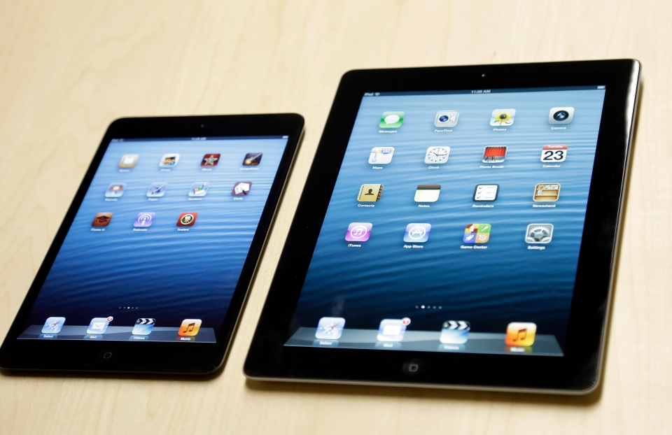The iPad mini, at left, is shown next to the 4th generation iPad in San Jose, Calif., Tuesday, Oct. 23, 2012. (AP / Marcio Jose Sanchez)