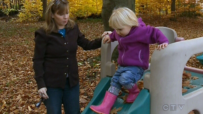 Two-year-old Ella tries out a slide in Montreal on Tuesday, Oct. 23, 2012.