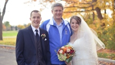 Stephen Harper poses in wedding photos