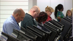 Voters cast early ballots at an advanced polling station in Columbus, Ohio on Tuesday, Oct. 23, 2012.