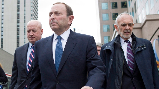 NHL commissioner Gary Bettman, left, leaves the NHLPA offices with deputy commissioner Bill Daly, left, and NHL lawyer Bob Betterman following collective bargaining talks in Toronto on Thursday, Oct. 18, 2012. (AP Photo/The Canadian Press, Chris Young)