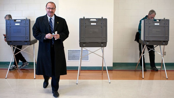 Calgary mayoral candidate Ric McIver walks away from a voting booth after marking his ballot in the City of Calgary municipal election in Calgary, Monday, Oct. 18, 2010. (Jeff McIntosh / THE CANADIAN PRESS)