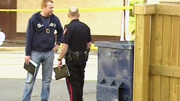 Police at the scene where an infant was found in a dumpster in Calgary on Tuesday, Oct. 19, 2010.