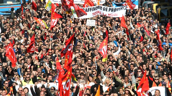 People march during a demonstration in Marseille, southern France, Tuesday, Oct.19, 2010. (AP / Claude Paris)