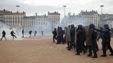 Youths clash with police in Lyon, central France, Tuesday, Oct. 19, 2010. (AP Photo / Laurent Cipriani)