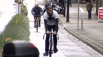 Cyclists are seen in a separated bike lane in downtown Vancouver in this Oct. 24, 2012 file image.