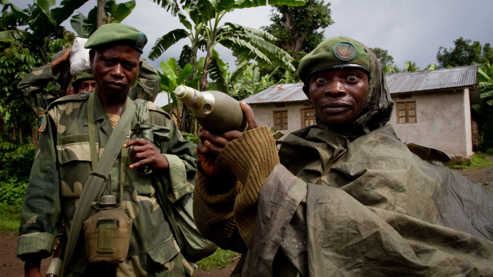 A Congolese government army soldier displays a mortar round after his unit returned from fighting against rebel forces, in Kinyamahura, Congo, May 17, 2012. (AP / Marc Hofer, File)
