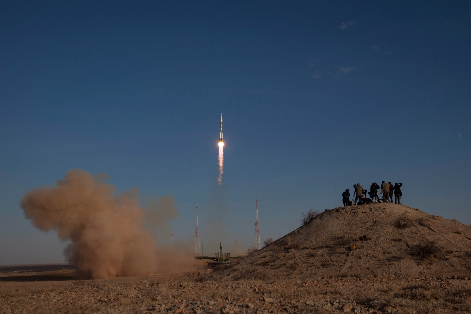 Members of the media photograph the Russian Soyuz rocket as it launches to the International Space Station from Baikonur, Kazakhstan on Tuesday, Oct. 23, 2012. (NASA / Bill Ingalls)