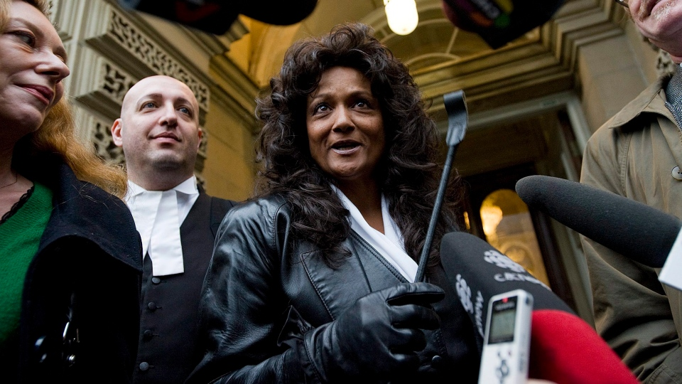 Dominatrix Terri-Jean Bedford holds a riding crop as she talks to media outside an Ontario Court of Appeal in Toronto, Monday, Nov. 22, 2010. (Aaron Vincent Elkaim / THE CANADIAN PRESS)