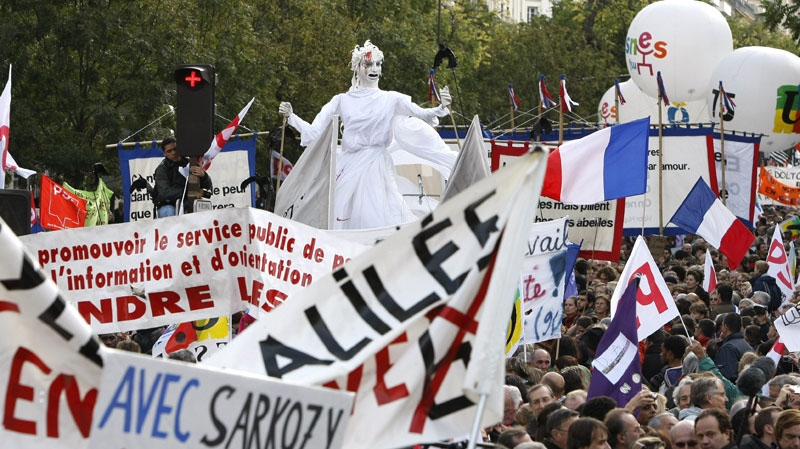 Demonstrators gather around a puppet symbolizing the French Republic during a protest in Paris, Tuesday Oct.19, 2010. (AP / Francois Mori)