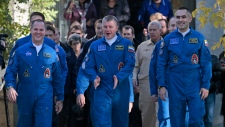 Crew members of Russian Soyuz rocket