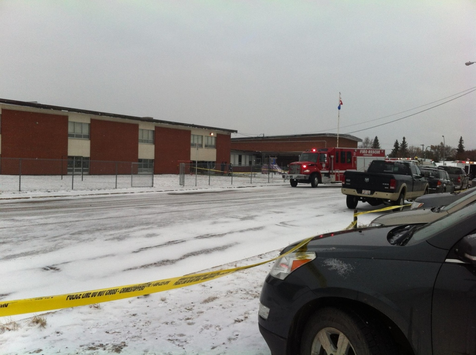 Emergency crews are seen outside of Racette Junior High School in St. Paul, Alta. after a van crashed into a classroom on Thursday, Oct. 25, 2012. (Photo courtesy of Mike Vanderhoek)