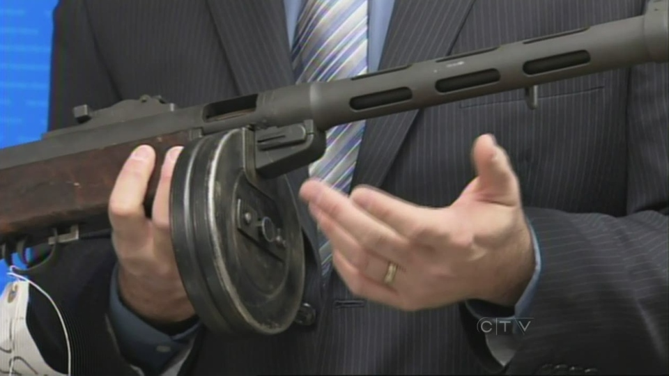 A gun seized as part of an RCMP investigation is displayed at a press conference in New Westminster, B.C., Thursday, Oct. 25, 2012.