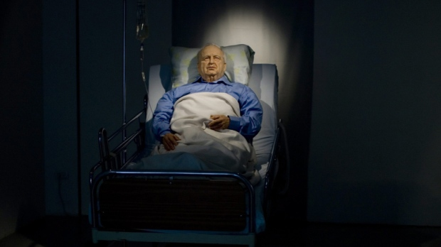 A life sized replica of former Israeli Prime Minister Ariel Sharon in hospital bed, an installation by Israeli artist Noam Braslavsky, is exhibited at the Kishon gallery in Tel Aviv, Israel, Tuesday, Oct. 19, 2010. The exhibition presenting Braslavky's artwork is due to open Thursday. Over four years after a devastating stroke, Ariel Sharon remains in a coma. (AP Photo/Ariel Schalit)